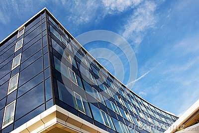 Modern glass architecture against the blue sky