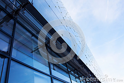 Modern glass architecture against sky