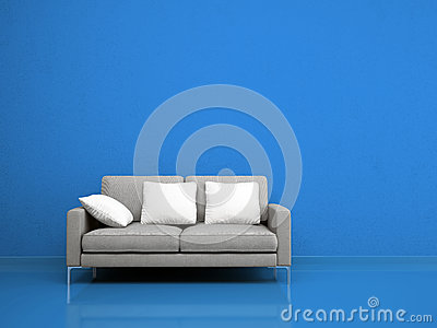 Modern grey sofa on the blue wall