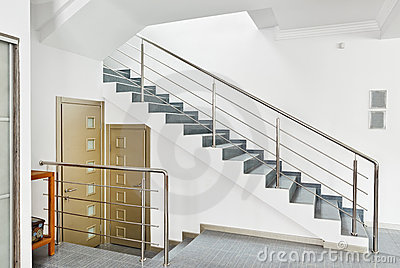 Modern hall with metal staircase interior