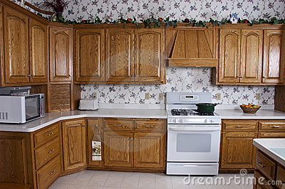 Modern home kitchen stove oak cabinets interior stock for Kitchen cabinets hialeah