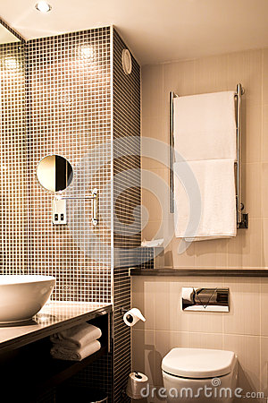 Modern Hotel Bathroom With Sink Mirror Tiles And Toilet