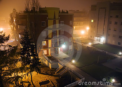 Modern houses in foggy night