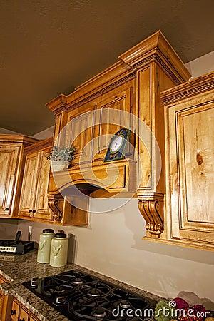 Modern Home Kitchen Cabinets Range Hood Stock Images - Image: 9931764