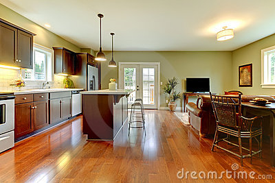 Modern kitchen with cherry floor and living room..