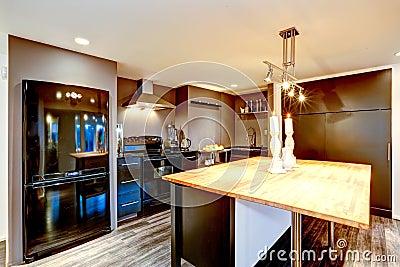 Modern Kitchen Interior In Dark Brown With Black