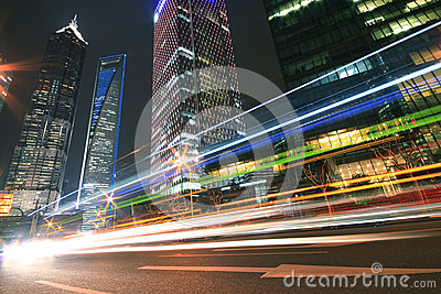 Modern landmark building background of car night with light trai