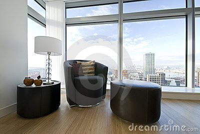 Modern leather armchair with taboret