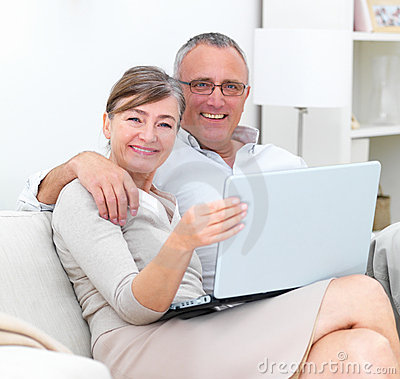 Modern lifestyle - Mature couple using laptop