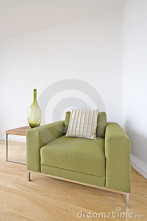Modern living room detail with green armchair