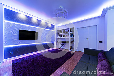 A modern living room with night light.