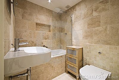 Modern luxury bathroom with natural stoned walls