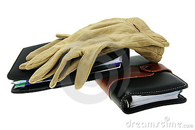 Modern notebooks and old gloves