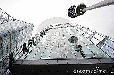 Modern obelisk and corporate building