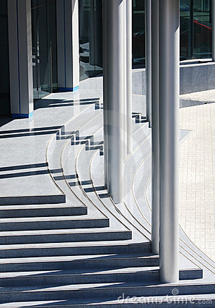 Modern office building entrance, steps and pillars