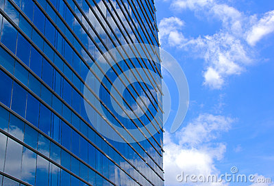 Modern office building and sky reflection