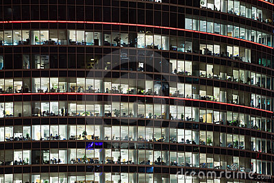 Modern office building with windows at night