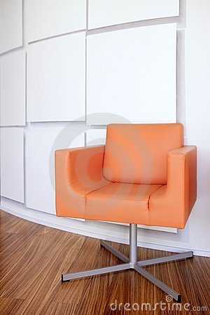 Modern office lobby with orange chair