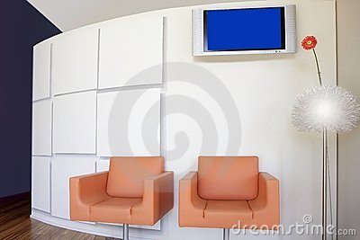 Modern office lobby with orange gerbera flower