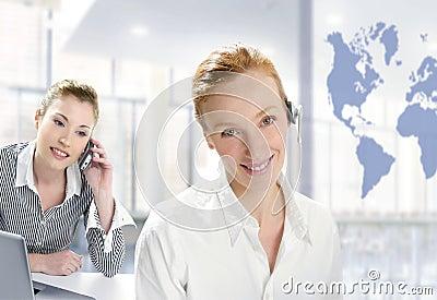 Modern office, two beautiful businesswoman