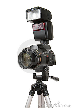 Modern photo camera with flash on tripod