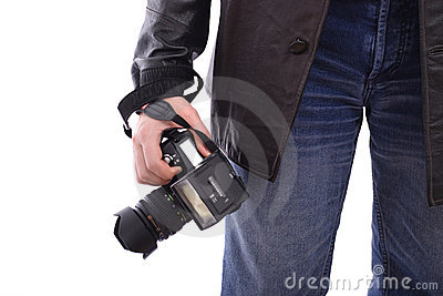 Modern photo SLR camera in photographer s hand