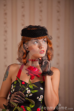 Modern pinup woman with piercing and tattoo