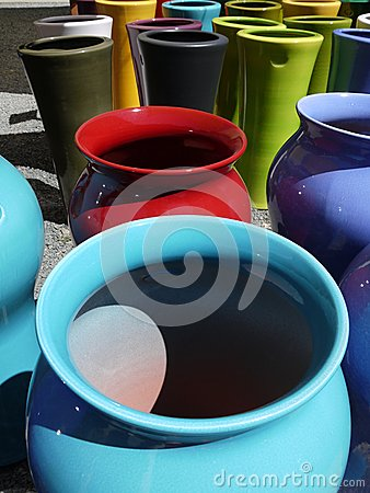 Modern pottery: colorful ceramic planters close