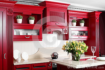 Modern red kitchen with stylish furniture