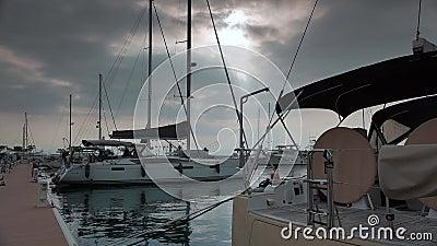 Modern sailing yachts moored in marina, 4k stock footage