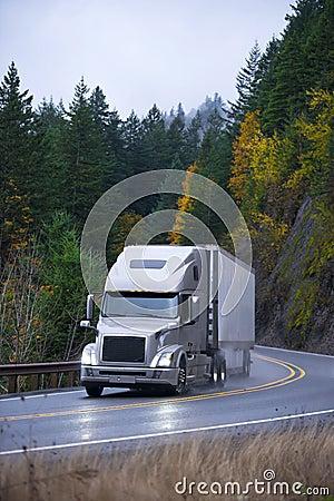 Free Modern Semi Truck Trailer In Rain Autumn Winding Road Stock Photo - 65163320
