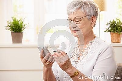 Modern senior woman with pda