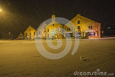 Modern Shops In Old Brick Buildings (at Night And In The ...  Modern Shops In...