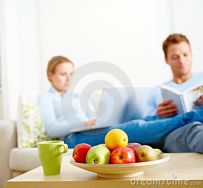 Modern Situations - Young couple sitting on couch