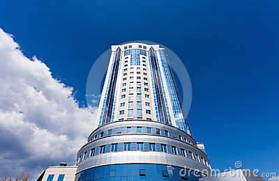 Modern skyscraper on blue sky background
