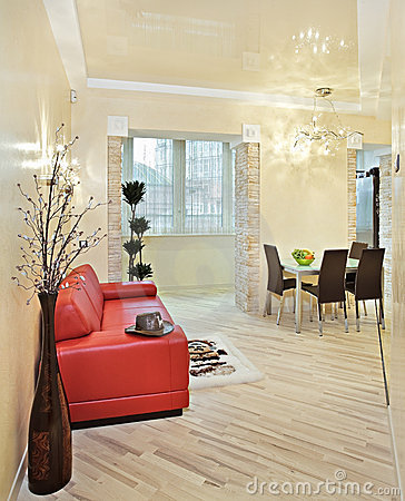 Modern studio interior with red sofa