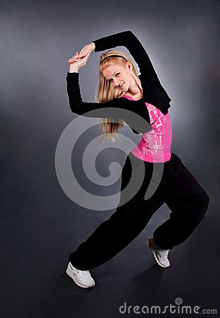 Modern style dancer posing over grey