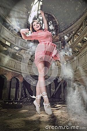Modern style dancer posing on theatre