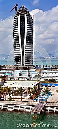 Modern tall building under construction in Sanya