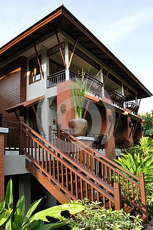 Free Modern Thai Style House Set Amid Magnificent Vegetation Stock Image - 105923801