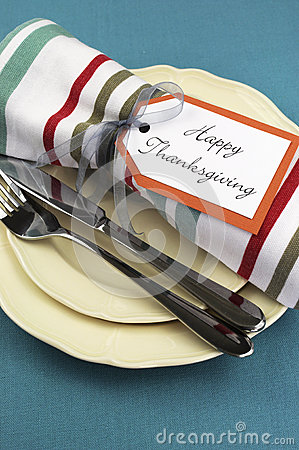 Modern Thanksgiving dining table setting on aqua tablecloth. Close up.