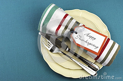 Modern Thanksgiving dining table setting on aqua tablecloth with copy space.