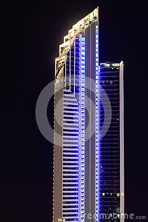 Modern tower building in blue at night