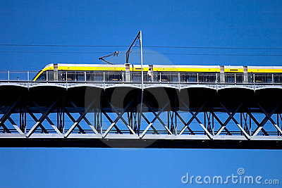 Modern tram on a steel bridge
