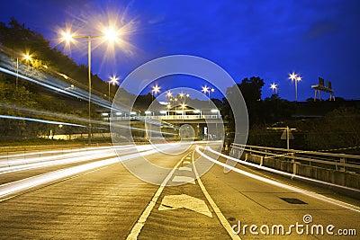 Modern Urban City with Freeway Traffic at Night,