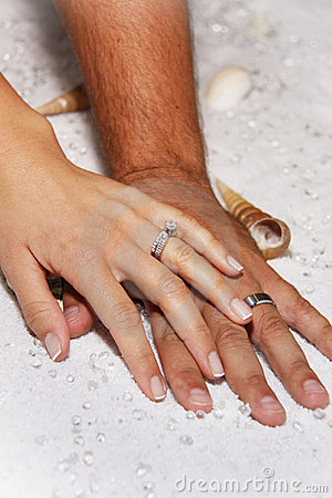 Modern Wedding hands in white sands