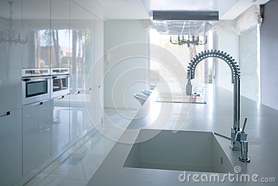 Modern white kitchen perspective with integrated bench