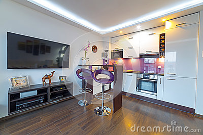 Modern white living room with kitchen