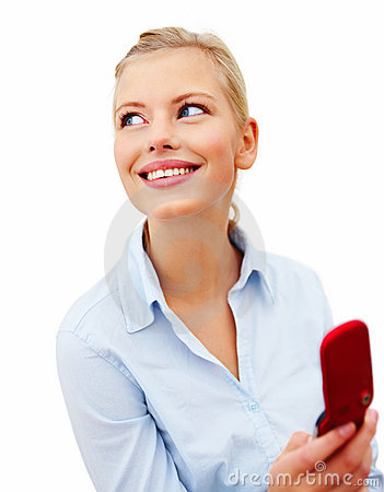 Modern woman using cell phone looking at copyspace