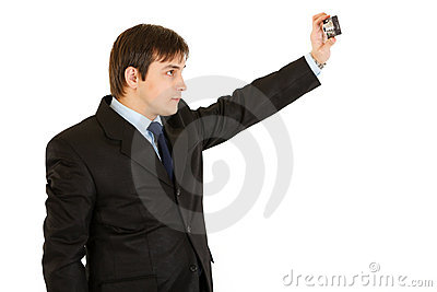Modern young businessman photographing himself